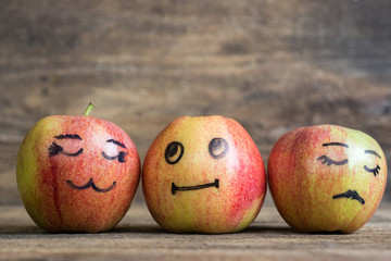 divorce and behavior – 3 apples with faces drawn on them image