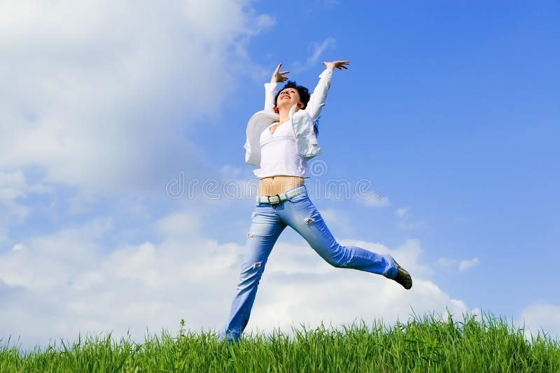 Woman jumping in field after stopping love addiction