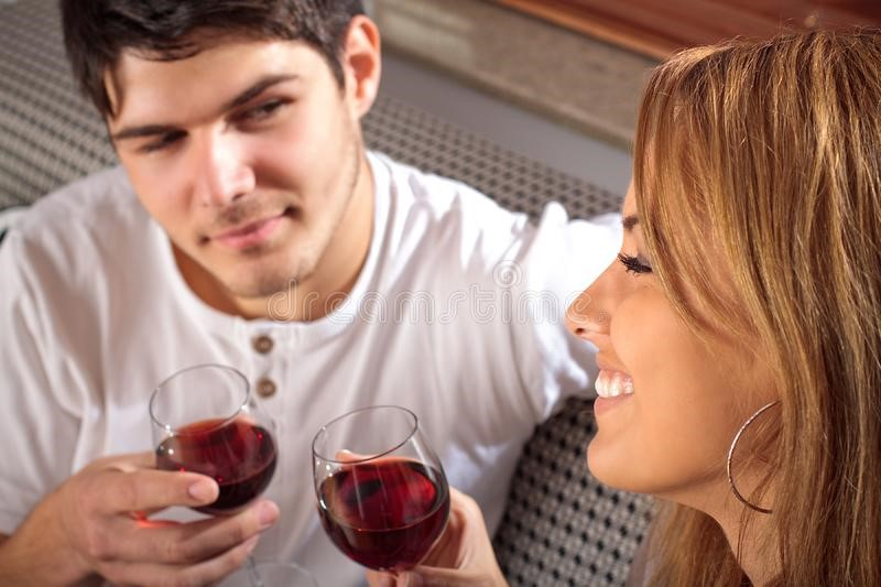 – Happy couple drinking wine image