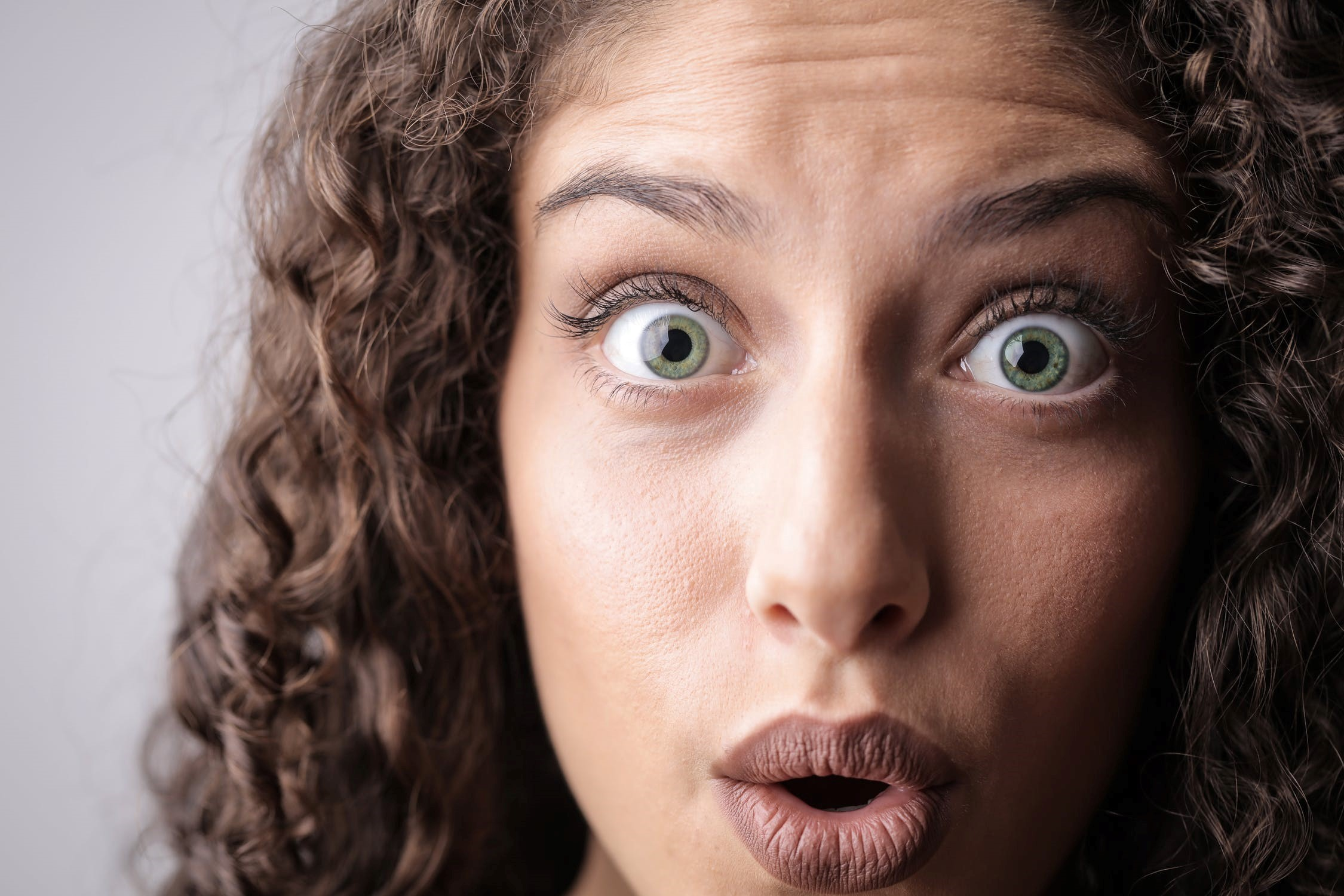 divorce lawyer Orlando - surprised woman with eyes wide open