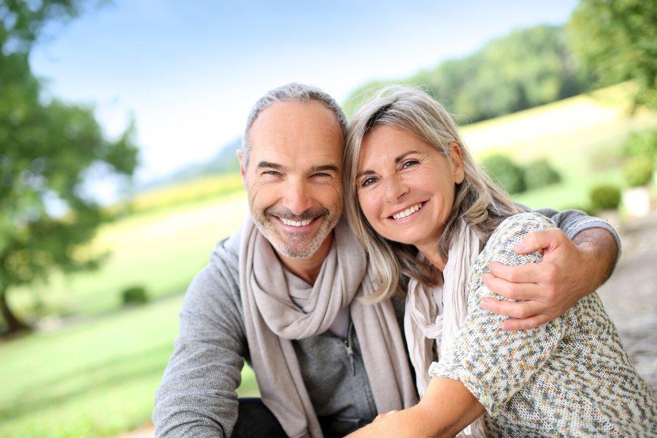 Divorce attorney orlando – happy married couple hugging smiling
